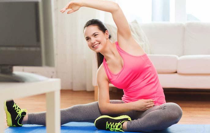 Girl exercising on Lauren Fox On Demand's online fitness programs